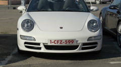 View of a white Porsche displayed in Saint-Tropez Stock Footage
