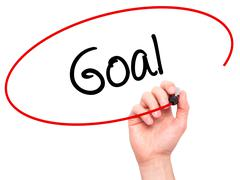 Man Hand writing Goal  with black marker on visual screen Stock Photos