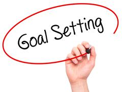 Man Hand writing Goal Setting  with black marker on visual screen - stock photo