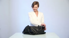 Woman gets out of the bag erotic lingerie and handcuffs for sex games Stock Footage