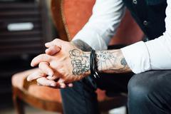 Serious man  with a tattoo on his arm Stock Photos