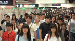 Massive crowds in subway metro station in Hong Kong, transport Asia Stock Footage