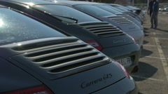 Rear view of the Porsche Carrera GTS and Porsche Carrera S in Saint-Tropez Stock Footage