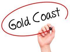 Man Hand writing Gold Coast with black marker on visual screen - stock photo
