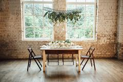 Wedding room decorated loft style with a table and accessories Stock Photos