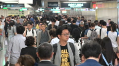 Subway passengers walk through corridor, public transport in Hong Kong Stock Footage