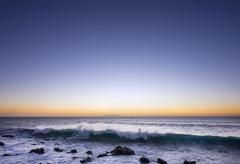 Ocean wave surf dusk island of El Hierro behind Valle Gran Rey La Gomera Canary Kuvituskuvat