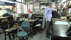 Small specialized tailor workshop in Hong Kong, Asia Stock Footage