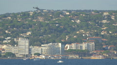 Helicopters flying above Saint-Tropez during the Bleuciel airshow - stock footage