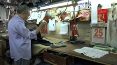 Stock Video Footage of Local tailor, craftsmanship, suits and garment, Hong Kong
