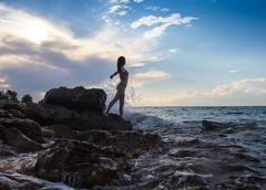 strong confidence woman open arms under the  sunrise at seaside - stock photo