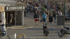 Tourists and locals walking on Quai Jean Jaures, in Saint-Tropez Stock Footage