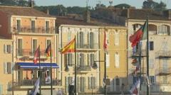 International flags waving on the seashore of Saint-Tropez Stock Footage