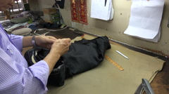Hands of a local tailor inside his workshop in Hong Kong Stock Footage