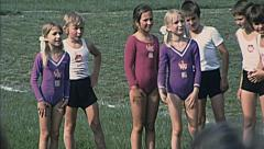 France 1975: children playing artistic gymnastics outdoor - stock footage