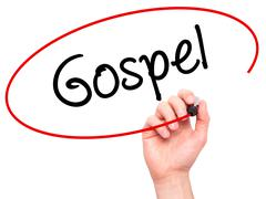 Man Hand writing Gospel  with black marker on visual screen - stock photo
