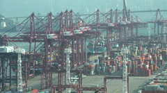 Hong Kong container terminal harbor cranes industry economy import export - stock footage