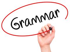 Man Hand writing Grammar with black marker on visual screen Stock Photos
