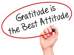 Man Hand writing Gratitude is the Best Attitude with black marker on visual s Stock Photos