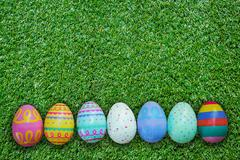 Easter egg on green grass texture and background - stock photo