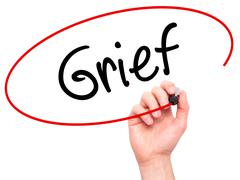 Man Hand writing Grief with black marker on visual screen - stock photo