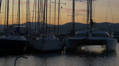 Pan view of yachts anchored in Saint-Tropez at dusk Stock Footage