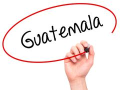 Man Hand writing Guatemala  with black marker on visual screen - stock photo