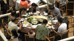 China family enjoys traditional hotpot meal in popular Hong Kong restaurant Stock Footage