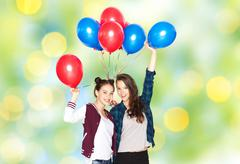 Happy teenage girls with helium balloons Stock Photos