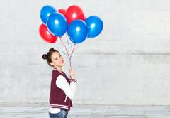Happy teenage girl with helium balloons Stock Photos