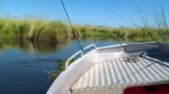 Power boat okavango delta Botswana Africa Stock Footage