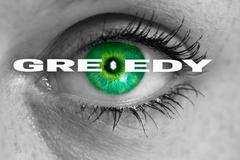 greedy eye looks at viewer concept macro - stock photo