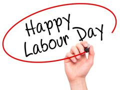 Man Hand writing Happy Labor Day with black marker on visual screen Stock Photos