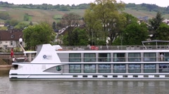 Tour boat at dock wait to load passengers for a cruise down the Rhine river. Stock Footage