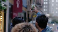 Group of multi-ethnic friends out on the town take a selfie on a city street Stock Footage