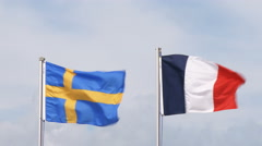 Swedish and French flags waving Stock Footage
