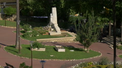 Walking next to the Jean Ossola monument in Jardin des Plantes, Grasse Stock Footage