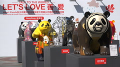 Panda bear statues on display at Hong Kong outdoor exhibition - stock footage