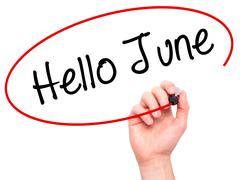 Man Hand writing Hello June  with black marker on visual screen Stock Photos