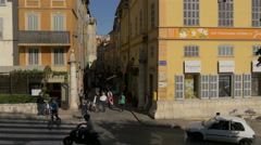 Walking and driving on Boulevard Fragonard, near Parfumerie Fragonard, Grasse Stock Footage