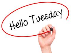 Man Hand writing Hello Tuesday with black marker on visual screen - stock photo