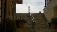 Walking on the stairs of Rue Mirabeau street in Grasse Stock Footage