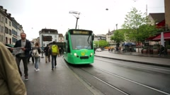 Trams on a street of Basel city. - stock footage