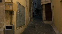 A narrow street with old buildings in Grasse Stock Footage