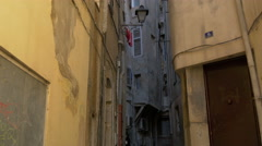 Narrow street with old buildings in Grasse Stock Footage