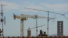 Tower of the Notre-Dame-du-Puy Cathedral, antennas and a crane seen in Grasse Stock Footage