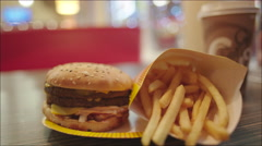 Burger and French Fries on the Plate Stock Footage