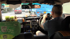 Driving a taxi through central Kowloon in Hong Kong Stock Footage