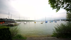 Yachts on a waterfront of Lake Zurich, Switzerland. Stock Footage
