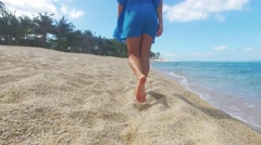 Young beautiful women in the blue on the sunny tropical beach Stock Footage
